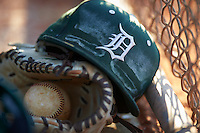 Dartmouth Big Green hat, glove, and baseball in the dugout during a game against the St. Bonaventure Bonnies on February 25, 2017 at North Charlotte Regional Park in Port Charlotte, Florida.  St. Bonaventure defeated Dartmouth 8-7.  (Mike Janes/Four Seam Images)