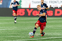 FOXBOROUGH, MA - AUGUST 29: Adam Buksa #9 of New England Revolution passes the ball during a game between New York Red Bulls and New England Revolution at Gillette Stadium on August 29, 2020 in Foxborough, Massachusetts.