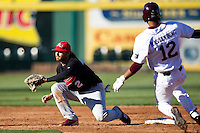 Matt Highland (2) of the Southern Illinois University- Edwardsville Cougars tries to pick off Trey Massenberg (12) of the Missouri State Bears as he tries to steal second during a game against the Missouri State Bears at Hammons Field on March 10, 2012 in Springfield, Missouri. (David Welker / Four Seam Images)