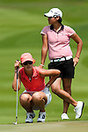 CHON BURI, THAILAND - FEBRUARY 20:  Michelle Wie of USA and Yani Tseng of Taiwan at the 1st green on during day four of the LPGA Thailand at Siam Country Club on February 20, 2011 in Chon Buri, Thailand. Photo by Victor Fraile / The Power of Sport Images
