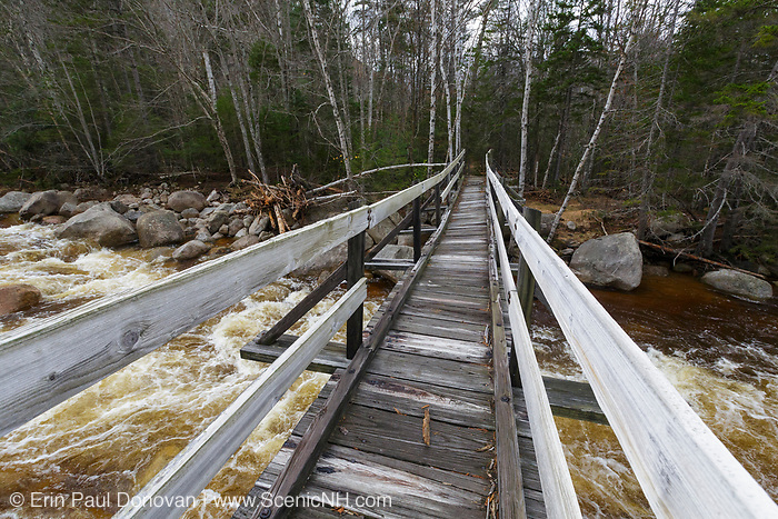 The Thoreau Falls Trail bridge, which crosses the East Branch of the Pemigewasset River, in the Pemigewasset Wilderness on October 31, 2017. On October 29-30 a storm consisting of heavy rain and strong winds caused extensive damage throughout New Hampshire. The East Branch of the Pemi River flooded around the Thoreau Falls Trail bridge, but the bridge looks to have been untouched. This bridge has a tilt to it that is visible in the photograph.
