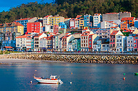 colorful houses and boat in harbor, A Guarda, Galicia, Pontevedra, Spain, Atlantic Ocean