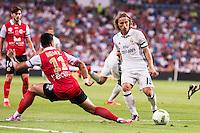 Real Madrid's player Luka Modric and Stade de Reims's player Rigonato during the XXXVII Santiago Bernabeu Trophy in Madrid. August 16, Spain. 2016. (ALTERPHOTOS/BorjaB.Hojas) /NORTEPHOTO