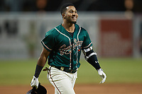 Lolo Sanchez (34) of the Greensboro Grasshoppers heads towards home plate after hitting a walk-off 2-run home run against the Hickory Crawdads at First National Bank Field on May 6, 2021 in Greensboro, North Carolina. (Brian Westerholt/Four Seam Images)