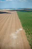 Eastern Colorado plains, farmer plowing with tractor. May 2014. 83921