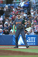 Brian Mundell (16) of the Boise Hawks takes throws at first base between innings of a game against the Hillsboro Hops at Ron Tonkin Field on August 22, 2015 in Hillsboro, Oregon. Boise defeated Hillsboro, 7-1. (Larry Goren/Four Seam Images)