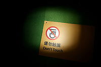CHINA. Beijing. A sign warns visitors to 'don't touch' in a stadium at the Beijing 2008 Summer Olympics. 2008
