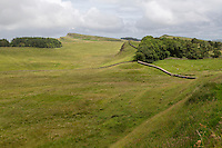 Northumberland, England, UK.  Knag Burn Gateway, middle right, as Hadrian's Wall Rises up Hill in Middle Distance.  Near  Housesteads Roman Fort (Vercovicium).