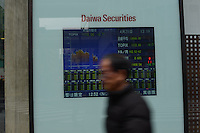 TV SCREEN SHOWS STOCK EXCHANGE RATE AT DAIWA SECURITIES IN SHIBUYA, TOKYO