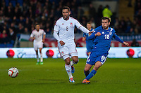 Wednesday 05 March 2014<br /> Pictured: ( L-R ) Hai Robson kanu of Wales kicks the ball past Theodor Elmar Bjarnason of Iceland<br /> Re: International friendly Wales v Iceland at the Cardiff City Stadium, Cardiff,Wales UK