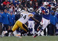 ORCHARD PARK, NY - NOVEMBER 28:  Steve Johnson #13 of the Buffalo Bills evades a tackle from Lawrence Timmons #94 of the Pittsburgh Steelers during the game on November 28, 2010 at Ralph Wilson Stadium in Orchard Park, New York.  (Photo by Jared Wickerham/Getty Images)