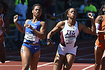 13 JUNE 2015: Dezerea Bryant of Kentucky crosses the finish line ahead of Kamaria Brown ahead of Texas A&M to win the Women's 200 meters during the Division I Men's and Women's Outdoor Track & Field Championship held at Hayward Field in Eugene, OR. Bryant won the event in a time of 22.18. Steve Dykes/ NCAA Photos
