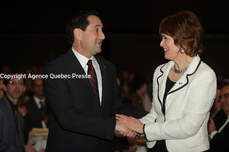 March 11 2013 - Montreal, Quebec,  CANADA  -  Michael Applebaum. Mayor of Montreal (L) greet Heather Munroe-Blum, O.C., O.Q., Ph.D., FRSC, Principal and Vice-Chancellor of McGill University (R) , before her speech at the Canadian Club of Montreal's podium