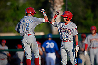 Clearwater Threshers Simon Muzziotti (12) celebrates with Nick Maton (6) after hitting a home run during a Florida State League game against the Dunedin Blue Jays on May 11, 2019 at Jack Russell Memorial Stadium in Clearwater, Florida.  Clearwater defeated Dunedin 9-3.  (Mike Janes/Four Seam Images)