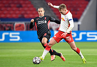 Football: Champions League, knockout round, round of 16, first leg, RB Leipzig - FC Liverpool at Puskas Arena. Liverpool's Thiago Alcantara and Leipzig's Dani Olmo battle for the ball.