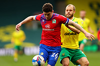 20th March 2021; Carrow Road, Norwich, Norfolk, England, English Football League Championship Football, Norwich versus Blackburn Rovers; Teemu Pukki of Norwich City fouls Darragh Lenihan of Blackburn Rovers