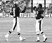 Jordan Case Ottawa Rough Riders quarterback with Condrege Holloway 1980. Copyright photograph Scott Grant/