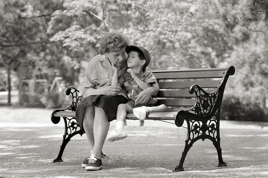 Grandma & Grandson on park bench. In the park with Grandma and Grandson. White grandmother with white grandson.