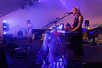 Pictured: Bass player Charlie Henderson and keyboard player and singer Sarah Downie of Drug Store Romeos perform at the Rising stage. Sunday 22 August 2021<br /> Re: Green Man Festival near Crickhowell, Wales, UK.