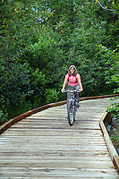 Bike riding on the Trail of Blue Ice, Portage Valley, Chugach National Forest, Alaska.