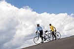 Cyclists on Mt Evans Road, near Idaho Springs, Colorado. Wildlife  photo tours to Mt Evans. .  John offers private photo tours in Denver, Boulder and throughout Colorado. Year-round.