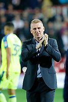 Dean Smith manager of Brentford applauds fans during the Sky Bet Championship match between Brentford and Derby County at Griffin Park, London, England on 26 September 2017. Photo by Carlton Myrie / PRiME Media Images.
