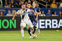 Sebastian Lletget #17 of the Los Angeles Galaxy moves with the ball