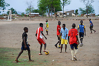 MOZAMBIQUE, Moatize, Cateme, this resettlement was constructed by brazil coal company VALE as compensation for relocated people from Chipanga, where VALE is extending its coal mining operations, football place / MOSAMBIK, Moatize, Siedlung Cateme, fuer die Erweiterung der Kohlemine des brasilianischen Unternehmens VALE wurde die Ortschaft Chipanga abgerissen, die Bewohner wurden 40 km von Moatize enfernt nach Cateme umgesiedelt, Fussball Platz
