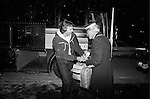 San Francisco 49er Joe Montana (L) fights to keep his luggage from coach Bill Walsh, masquerading as a bellhop as the 49ers arrived at their hotel in Detroit, January 17, 1982. Photo was taken by Frederic Larson: 01/17/1982.