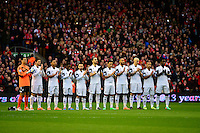 Sunday, 23 February 2014<br /> Pictured: The Swansea City players applaud the memory of Sir Tom Finney<br /> Re: Barclay's Premier League, Liverpool FC v Swansea City FC v at Anfield Stadium, Liverpool Merseyside, UK.