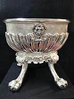 Antique dealer turned 210lbs of scrap silver into 17th century-style wine cistern worth £250k.