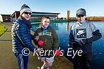 Gerard, Lisa and Michael O'Shea enjoying the cold weather around the frozen lake in the Tralee Bay Wetlands on Sunday.