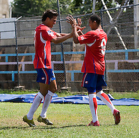 John Ruiz (9) of Costa Rica celebrates his goal with teammate William Fernandez (2) during the group stage of the CONCACAF Men's Under 17 Championship at Jarrett Park in Montego Bay, Jamaica. Costa Rica defeated El Salvador, 3-2.