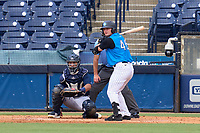 Tampa Tarpons outfielder Ryder Green (46) bats during a game against the Lakeland Flying Tigers on July 18, 2021 at George M. Steinbrenner Field in Tampa, Florida.  Also shown catcher Gresuan Silverio (51).  (Mike Janes/Four Seam Images)