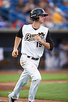 Quad Cities River Bandits center fielder Kyle Tucker (19) runs to first base during a game against the Bowling Green Hot Rods on July 24, 2016 at Modern Woodmen Park in Davenport, Iowa.  Quad Cities defeated Bowling Green 6-5.  (Mike Janes/Four Seam Images)