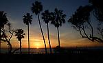 The sun sets over the Pacific Ocean at Mahattan Beach, CA.