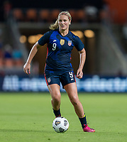 HOUSTON, TX - JUNE 13: Lindsey Horan #9 of the USWNT dribbles during a game between Jamaica and USWNT at BBVA Stadium on June 13, 2021 in Houston, Texas.
