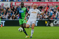 Saturday 4th  October 2014 Pictured: ( L-R )  Moussa Sissoko go Newcastle United tries to get past Jonjo Shelvey of Swansea City <br /> Re: Barclays Premier League Swansea City v Newcastle United at the Liberty Stadium, Swansea, Wales,UK