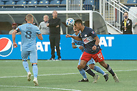 FOXBOROUGH, MA - SEPTEMBER 19: Brandon Bye #15 of New England Revolution heads the ball forward during a game between New York City FC and New England Revolution at Gillette on September 19, 2020 in Foxborough, Massachusetts.