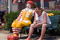 Sunny Beach, Nesebar, Bulgaria..A British woman in front of a MacDonalds restaurant at Sunny Beach, the largest holiday resort in the Balkans, and a popular destination for cheap foreign package tours.