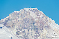 Detailed view of the snow-capped peak of Mount Illiamna, an active volcano, in Lake Clark National Park, Alaska.  The mountain is over 10,000 feet tall.