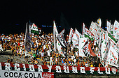 Rio de Janeiro, Brazil. Crowd of Fluminense football supporters waving banners at a match; Maracana football stadium.