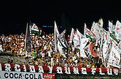 Rio de Janeiro, Brazil. Crowd of Fluminense football supporters waving banners at a match; Maracana football stadium.