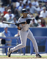 Brian Hunter of the Houston Astros bats during a 2002 MLB season game against the Los Angeles Dodgers at Dodger Stadium, in Los Angeles, California. (Larry Goren/Four Seam Images)
