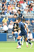 KANSAS CITY, KS - JUNE 26: Gianluca Busio #10 Sporting KC heads the ball during a game between Los Angeles FC and Sporting Kansas City at Children's Mercy Park on June 26, 2021 in Kansas City, Kansas.