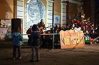 """Sete (Elisabetta D'aiuto Singer, Songwriter, Musician).<br /> <br /> Rome, 19/12/2020. Today, the Nuovo Cinema Palazzo Community held a third public assembly (1.) in Rome's San Lorenzo district to protest against the eviction of the """"Nuovo Cinema Palazzo"""" completed by the Italian police forces in the early morning of the 25th of November and to demonstrate against the violent reaction of the Police forces when, in the evening of the same day, a large demo asked to have the chance to hold a public assembly in the square (Piazza dei Sanniti) of the cinema (2.). The public assembly of today saw the participation, performances, support & solidarity of the representatives of movements, actors, musicians, poets, students, artists, and citizens of San Lorenzo who told their stories and memories related to the famous Rome's Art and culture occupation.<br /> The Nuovo Cinema Palazzo was occupied the 15th of April 2011, when citizens, movements, workers of the entertainment industry reopened the former """"Palazzo Cinema"""" to prevent the opening of a casino/gambling space. The illegal occupation was intended as a public hub of art, culture, sport and politics, an open place for exchange, discussion, studies, caring and sharing.<br /> <br /> Footnotes & Links:<br /> 1. http://bit.do/fL2Vu<br /> 2. 25.11.2020 - Demo And Clashes Against Nuovo Cinema Palazzo Eviction in Rome's San Lorenzo: http://bit.do/fLxgz<br /> Previous Public Assemblies: http://bit.do/fLCr3 & http://bit.do/fL2VR & http://bit.do/fL2Y5<br /> Videos of the Event: http://bit.do/fL2Wc & http://bit.do/fL2V6"""