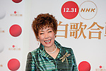 """Dec. 29, 2009 - Enka singer, Junko Akimoto, poses for photographers during the first day of rehearsals for 'Kohaku Uta Gassen,' or also more commonly known as 'Kohaku.' Produced by the Japanese public broadcaster, NHK, this annual music show airs on New Year's Eve and ends shortly before midnight, where everyone on air pauses to say """"Happy New Year."""" The 'Red and White Song Battle' separates the most popular music artists during each given year into teams of red and white: the red team consists of all female artists and the white team is all male artists. For an artist to perform on Kohaku, it is a great honor as only the most successful enka singers and J-Pop artist are strictly invited to perform by invitation only. Today, for a J-Pop artist or enka singer to perform on Kohaku, is most notably recognized to be a big highlight in a singer's career due to the show's large reach of audience during New Year's Eve."""
