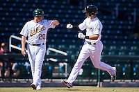 Mesa Solar Sox manager Ryan Christenson (20), of the Oakland Athletics organization, congratulates Brian Anderson (14), of the Miami Marlins organization, after hitting a home run during a game against the Surprise Saguaros on October 14, 2016 at Sloan Park in Mesa, Arizona.  Mesa defeated Surprise 10-4.  (Mike Janes/Four Seam Images)