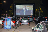 """Democratic nominee for President Joe Biden is seen wearing a facemask on a screen as people gathered to watch the 2020 Democratic National Convention at a """"Ridin' with Biden"""" Drive-In Theater viewing event at Suffolk Downs in Boston, Massachusetts, on Wed., Aug. 19, 2020."""