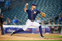 Northwest Arkansas Naturals relief pitcher Reid Redman (12) delivers a pitch during a game against the Midland RockHounds on May 27, 2017 at Arvest Ballpark in Springdale, Arkansas.  NW Arkansas defeated Midland 3-2.  (Mike Janes/Four Seam Images)